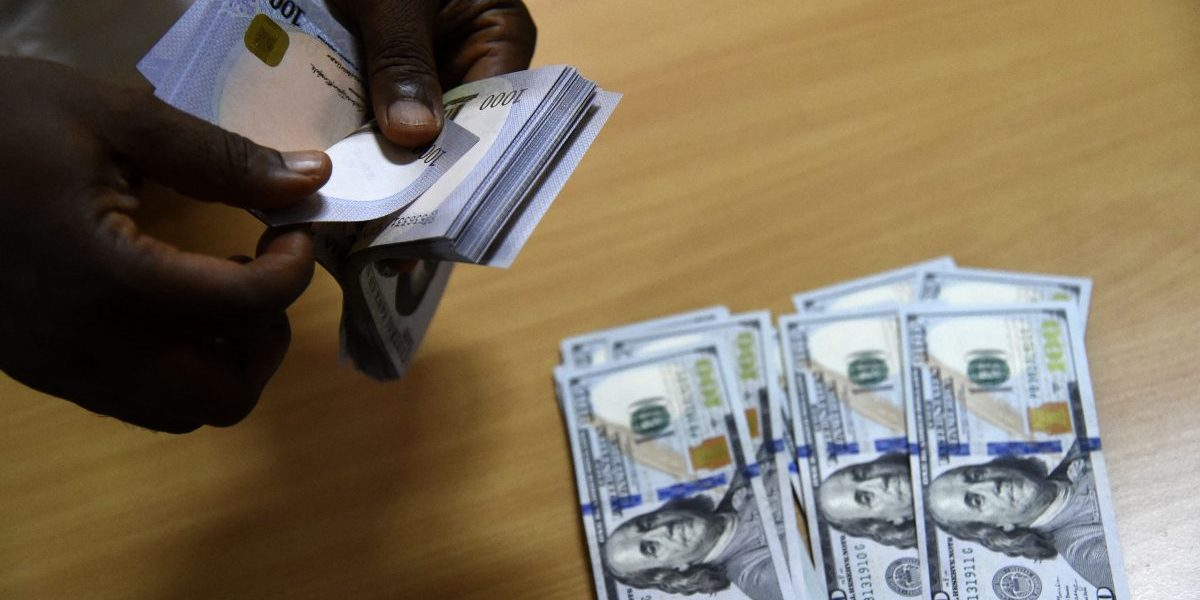 Cover image: A man exchanges Nigeria's currency, Naira, for US dollars in Lagos, Nigeria. Image: Getty, Pius Utomi Ekpei/AFP