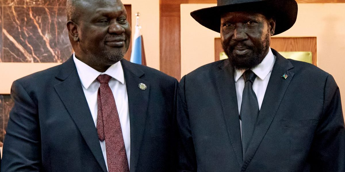 South Sudanese President Salva Kiir (R) shakes hands with First Vice President Riek Machar as he attends his swearing-in ceremony at State House in Juba, South Sudan on February 22, 2020. Image: Getty, Alex Mcbride/AFP