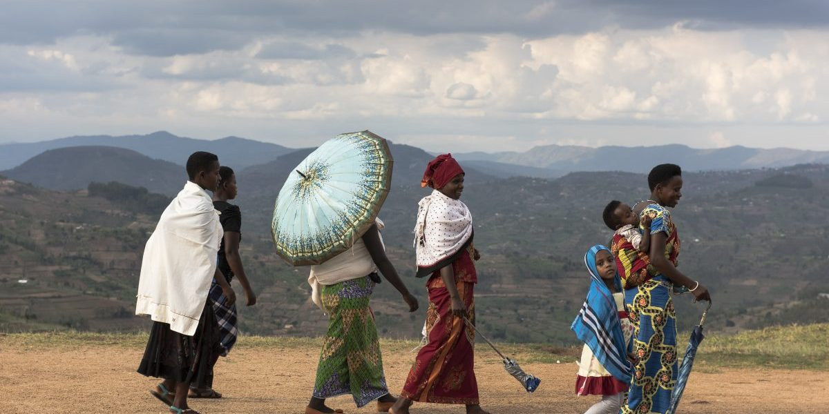 Kayumbu, Rwanda: A group of women walking in the Rwandan countryside. Rwanda is the most densely populated country in Africa. There are an estimated 352 people/square kilometer. Image: Getty, William Campbell-Corbis