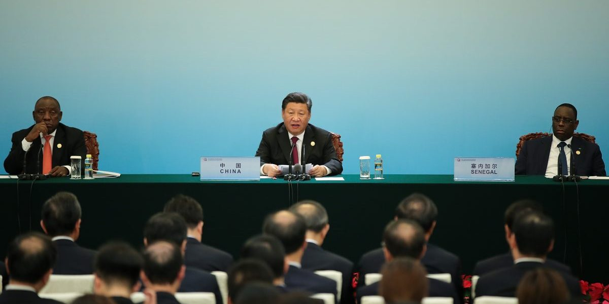 Chinese President Xi Jingping (C) with South African President Cyril Ramaphosa (L) attend the 2018 Beijing  Summit Of The Forum On China–Africa Cooperation – Joint Press Conference at the Great Hall of the  People. Image: Getty, Lintao Zhang