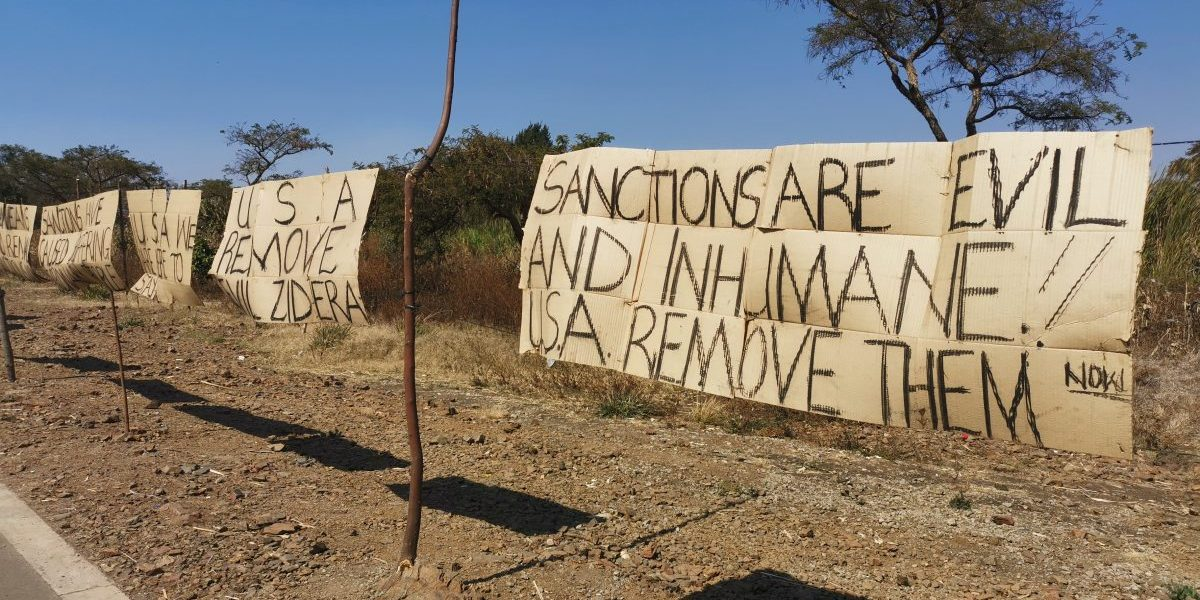 Protest signs from demonstrators camped outside the US Embassy in Harare calling for the lifting of sanctions on Zimbabwe, on 1 August 2019. Image: Aditi Lalbahadur