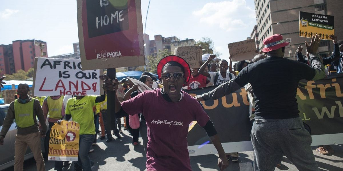 Hundreds of protesters carry placards as they march during an anti-xenophobia demonstration in Johannesburg, South Africa on April 23, 2015. Image:Getty, Ihsaan Haffejee