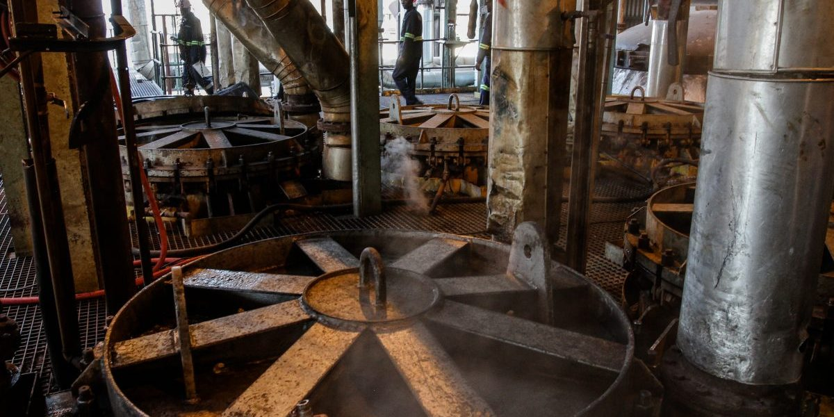 Workers perform maintenance on machinery used for processing sugarcane at the Sezela Mill, operated by Illovo Sugar, in Sezela, South Africa. Image: Getty, Dean Hutton/Bloomberg