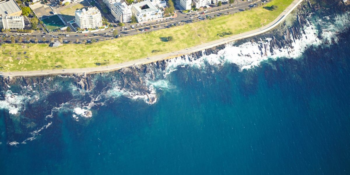 Aerial shot of the urban coastline of Cape Town, South Africa. Image: Getty, AnneBaek