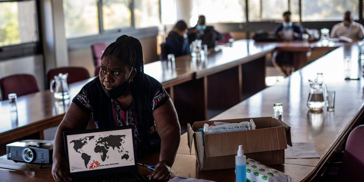 Doctors Without Borders (MSF) nurse Bhelekazi Mdlalose, sets up her computer to be used during a COVID-19 coronavirus training course for nurses at the City of Joburg Civic Centre in Roodeport, Johannesburg, on May 13, 2020. Image: Getty, Michele Spatari/AFP