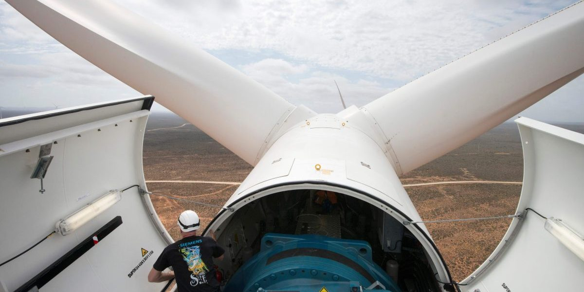 Engineer Lars Birkmann looks on from a wind turbine at the Sere Wind farm, close to Vredendal, about 350 km from Cape Town. Image: Getty, Rodger Bosch/AFP