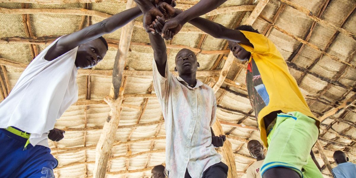 Young refugees from Sudan practice an activity on