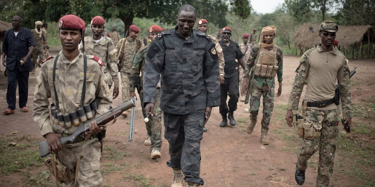 The leader of Union for Peace in Central African Republic (UPC) armed group, Ali Darassa (C), walks with his security forces, in the city of Bokolobo. Image: Getty, Florent Vergnes / AFP