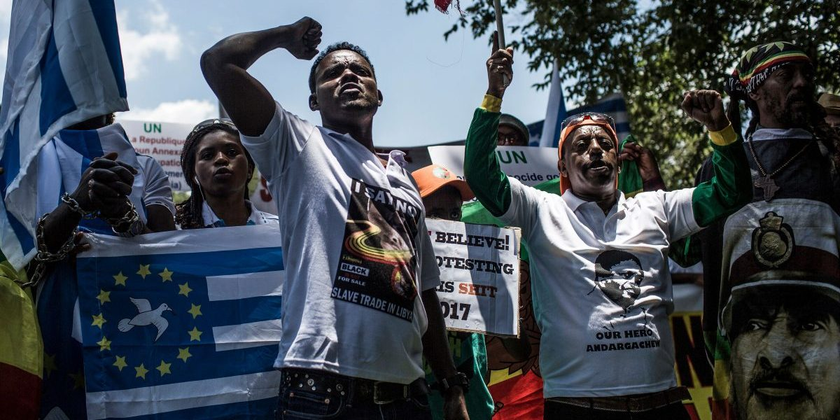 Members of the Africa Diaspora Forum (ADF), civil society organisations, churches, trade unions and other coalitions shout slogans during a demonstration against the slave trade and human trafficking in Libya at the Union Buildings in Pretoria. Image: Gulshan Khan/AFP