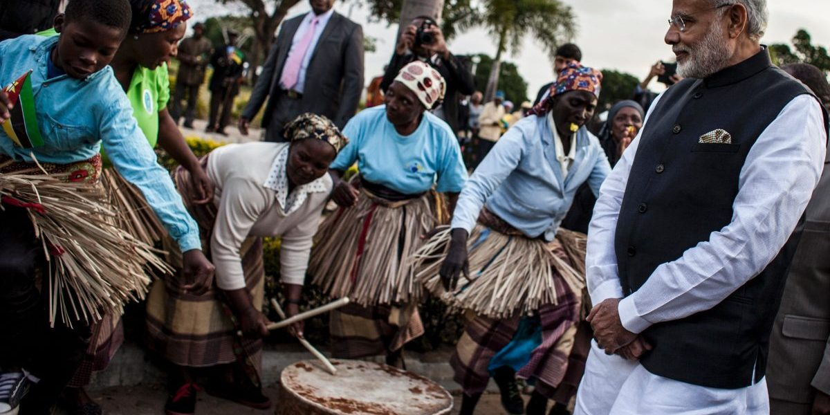 Indian Prime Minister Narendra Modi looks at a band playing, as he arrives for a visit to the Centre for Innovation and Technological Development in Maputo. Image: Getty, John Wessels/AFP