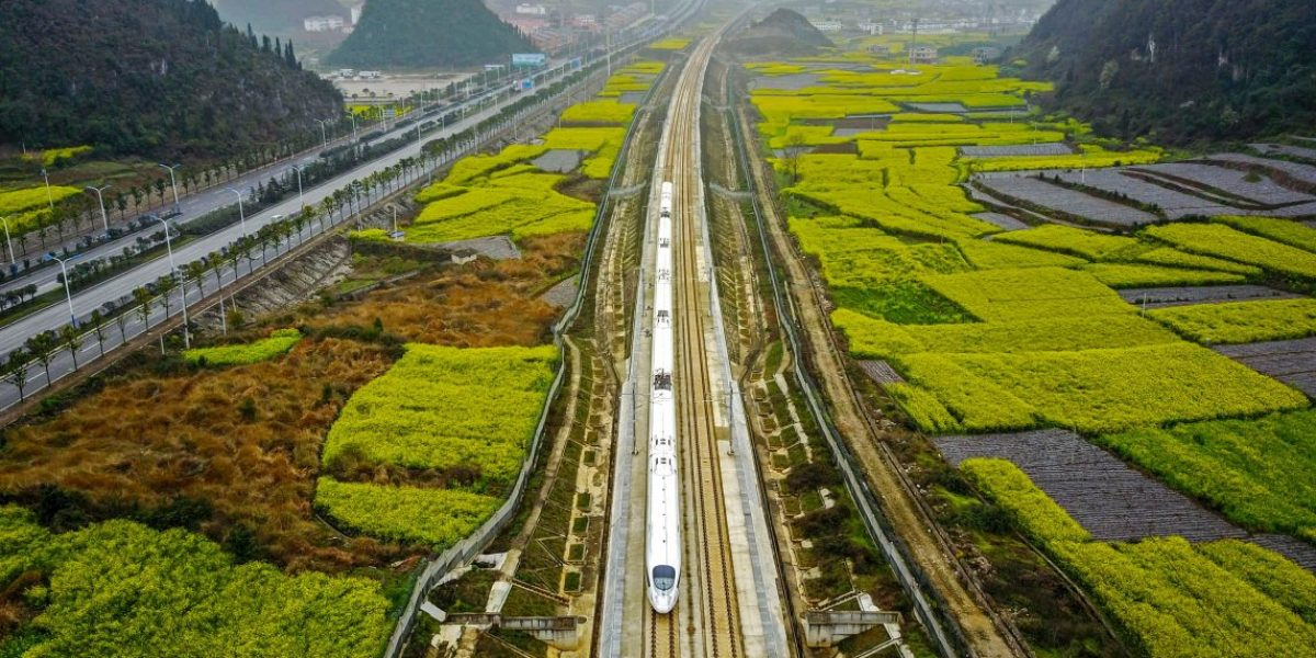 This aerial photo taken on March 16, 2017 shows a high-speed train traveling on the railway in Anshun, southwest China's Guizhou province. Image: Getty, Johnston Earley/AFP