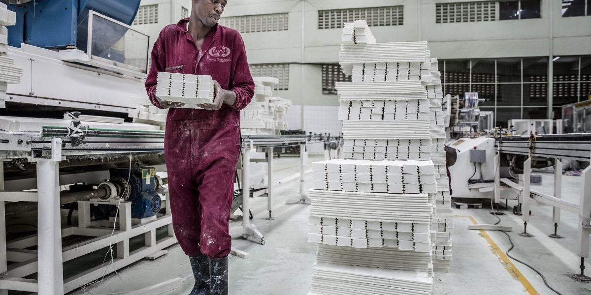 A worker stacks shaped Msafi washing soap bars ready for packaging on the production line at the Bidco Africa Ltd. factory in Thika, Kenya on Friday, Sept. 14, 2018. Image: Getty,  Luis Tato/Bloomberg