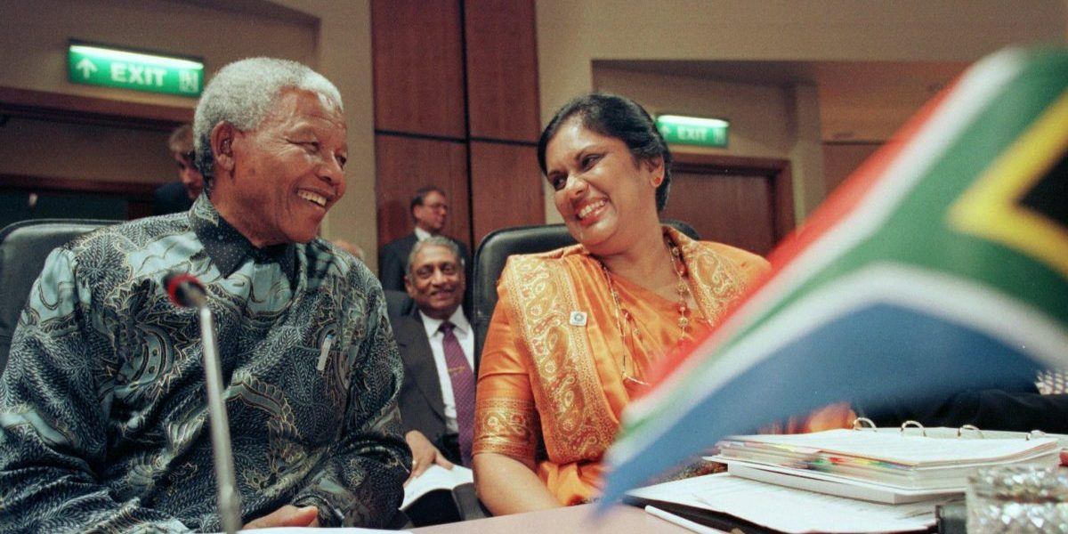24 October 1997: South African President Nelson Mandela and Sri Lankan President Chandrika Bandaranaike Kumaratunga laugh together before the first session of the Commonwealth Heads of Government Meeting. Image: Getty, AFP / Kevin Lamarque
