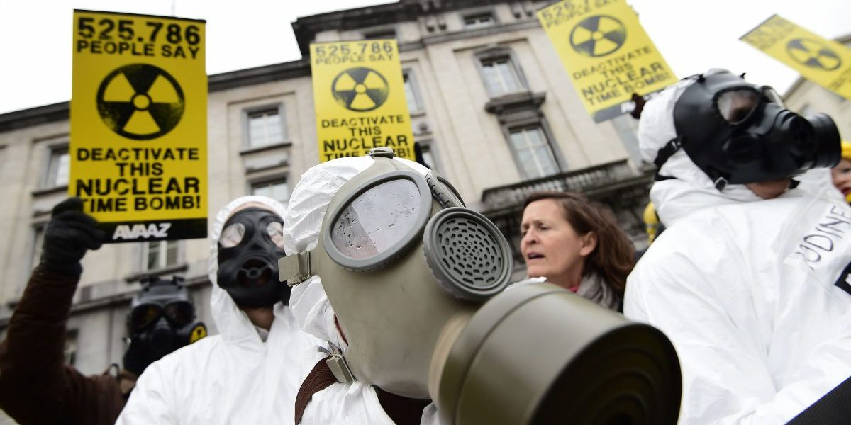 Anti-nuclear activists stage a protest against the lack of safety of Belgian nuclear power plants, outside the Belgian Interior Ministry in Brussels. Image: Getty Emmanuel Dunand/AFP