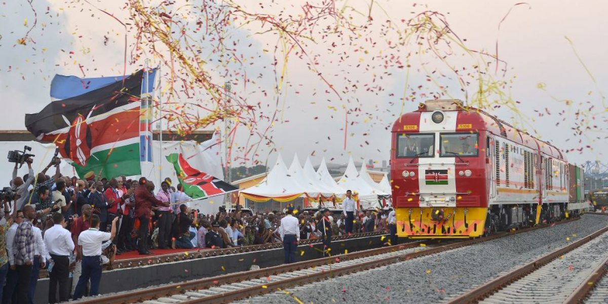 Kenyan President Uhuru Kenyatta flags off a cargo train, as it leaves the container terminal for its inaugural journey to Nairobi, at the port of the coastal town of Mombasa on May 30, 2017. Image: Getty, AFP / Tony Karumba
