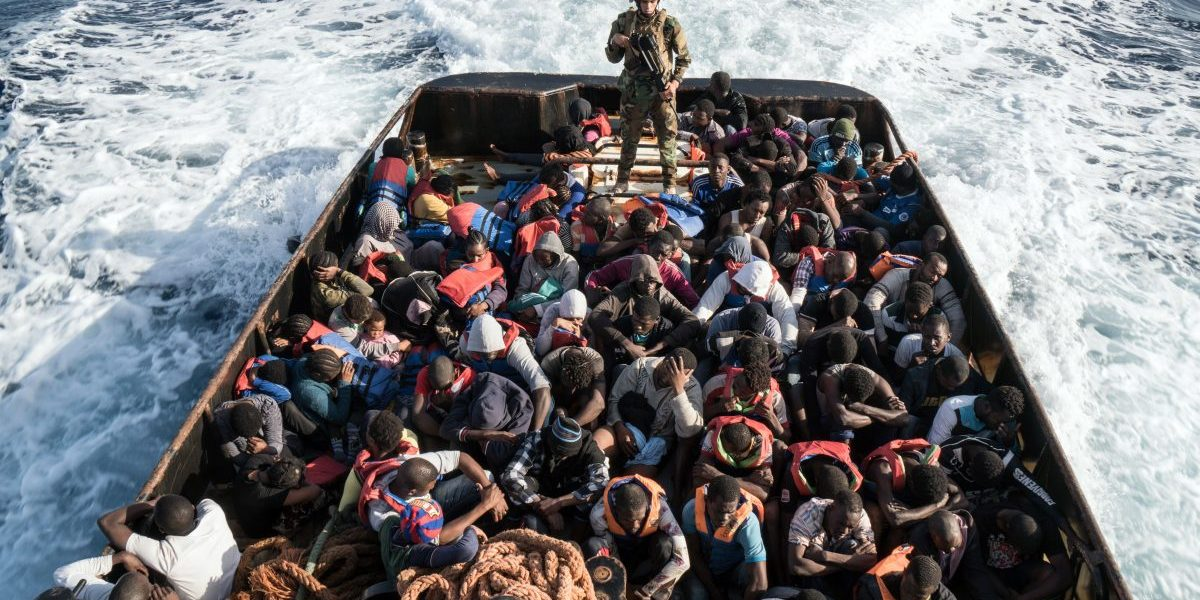 A Libyan coast guardsman stands on a boat during the rescue of 147 illegal immigrants attempting to reach Europe. Image: Taha Jawashi/AFP/Getty Images