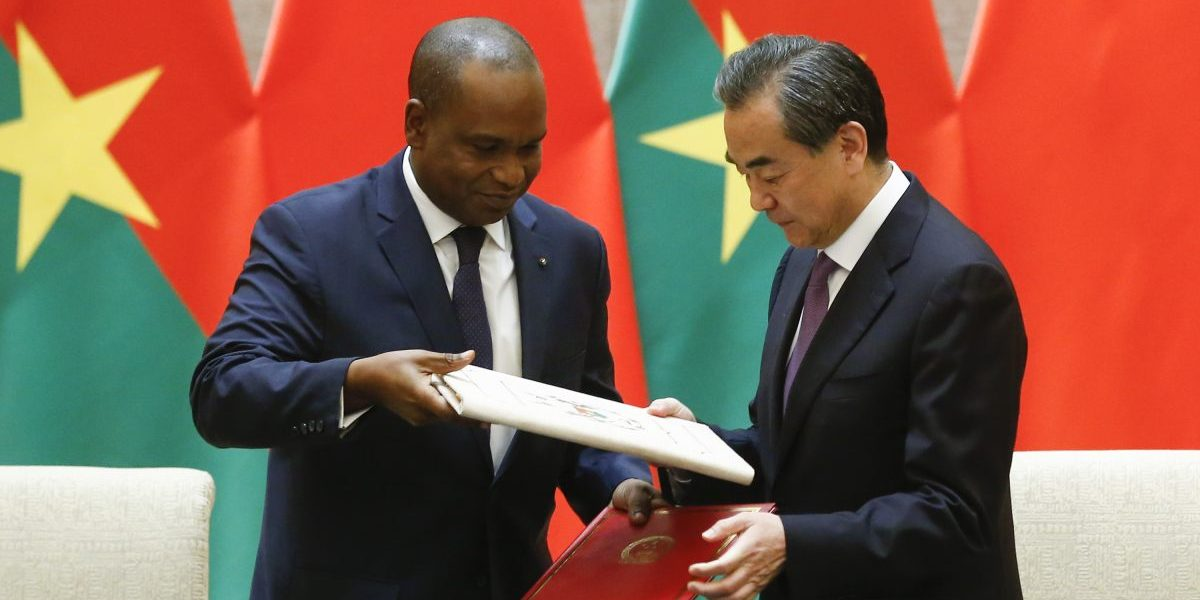 China's Foreign Minister Wang Yi and Burkina Faso Foreign Minister Alpha Barry attend a signing ceremony establishing diplomatic relations between the two countries on May 26, 2018 in Beijing, China. Image: Getty, Thomas Peter