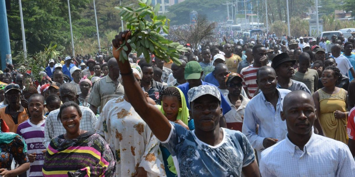 People gather to demonstrate outside the office of the United Nations Human Rights Commissioner in Bujumbura. Image: Getty, Tony Karumba/AFP