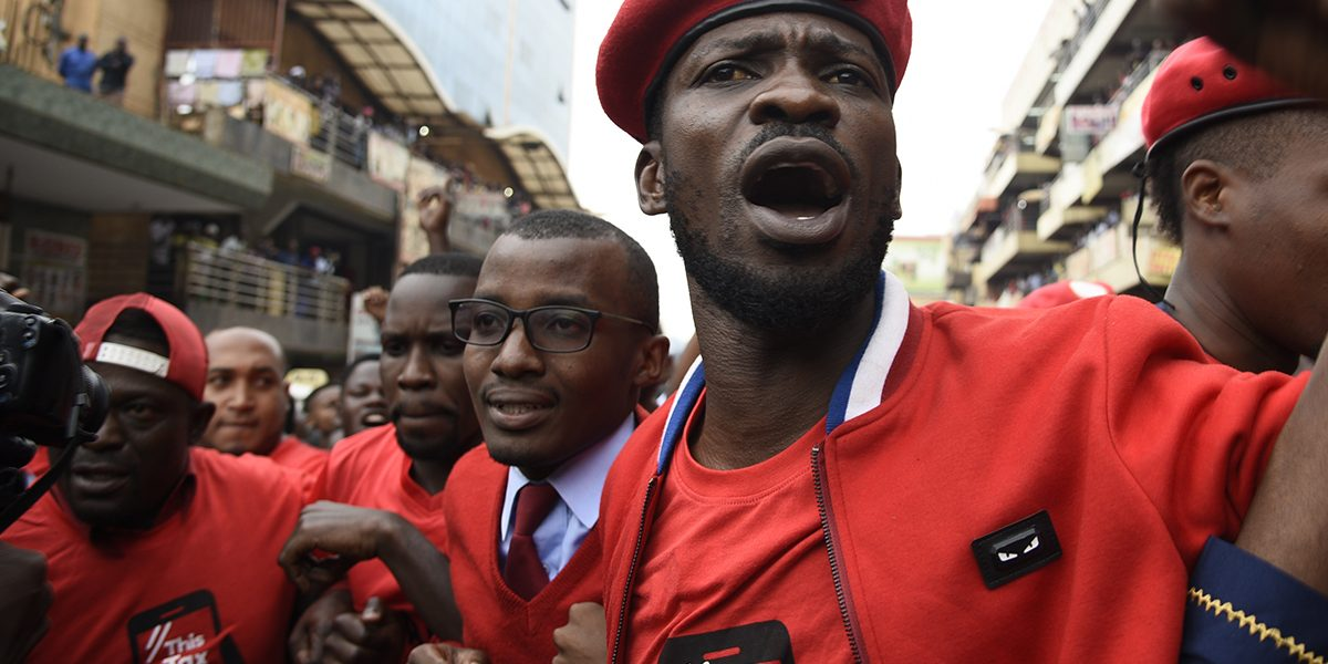 Musician turned politician Robert Kyagulanyi Ssentamu aka Bobi Wine (C) is joined by activists in Kampala on 11 July 2018 to protest a controversial tax on the use of social media. Image: Getty, Isaac Kasamani/AFP