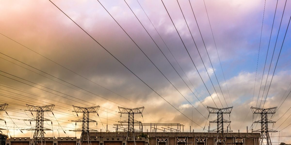Electricity pylons from a substation at sunset. Image: Getty, THE GIFT 777