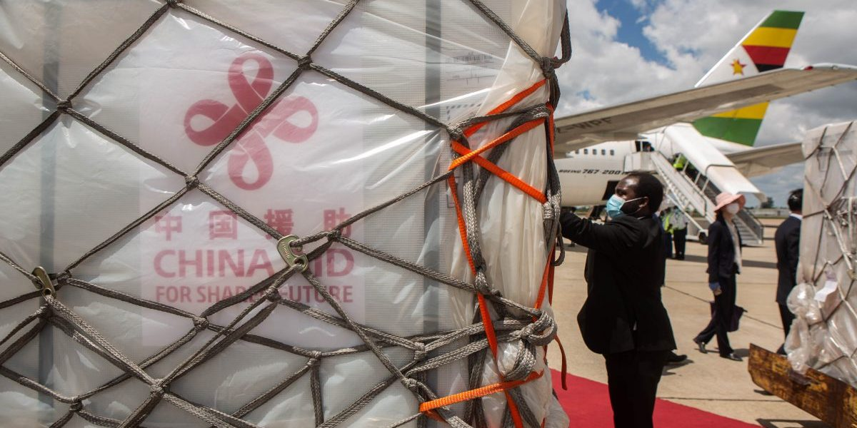 Zimbabwean officials inspects the shipment of the Sinovac and Sinopharm vaccines at Harare International Airport on March 16, 2021 in Harare, Zimbabwe. Image: Getty, Tafadzwa Ufumeli