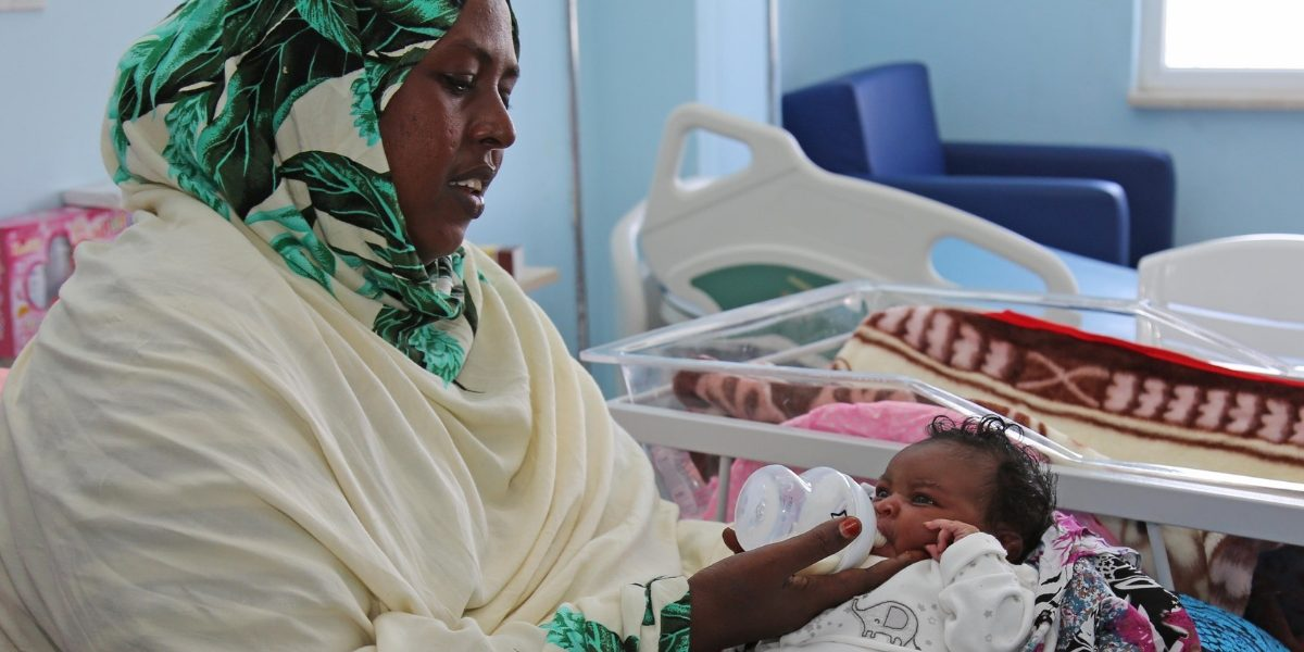 A Somalian woman takes care of her baby at a Turkish hospital in Mogadishu. Image: Getty, Sadak Mohamed