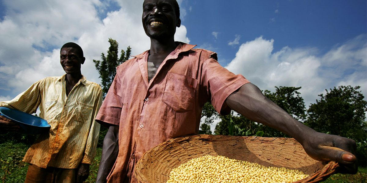Two soy farmers stand with their product on their small plot of land in the Sauri Millenium village locale, September 11, 2007 in Kisumu, Kenya. Image: Getty, Brent Stirton