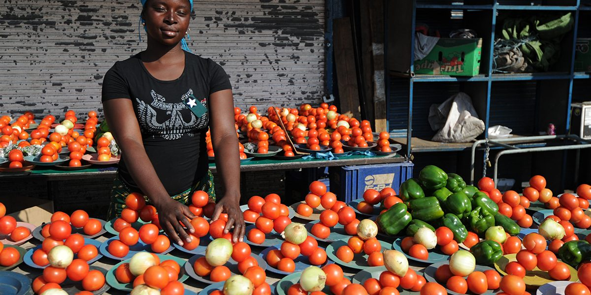 A roadside vendor sells tomatoes, onions and green peppers at the Alexandra township, near Johannesburg, South Africa. Image: Getty, Monirul Bhuiyan/AFP